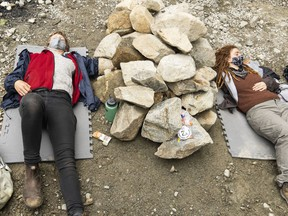 Two protesters locked themselves under a pile of rocks to block the path of loggers in 2000 Block in protest of logging old-growth forest in British Columbia, near Port Renfrew B.C., on May 25, 2021.