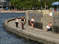 People enjoy the weather in Vancouver, BC, June 23, 2021.