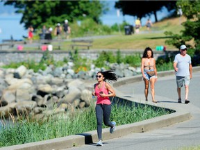 A jogger braves the heat near English Bay in Vancouver on Sunday amid record high temperatures.