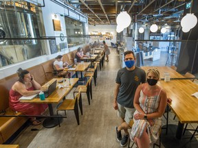 Kyle O'Genski and Sarah Harbord opened their Patina Brewing in Port Coquitlam early on Monday to accommodate patrons who usually work from home but were desperate for some air conditioning.