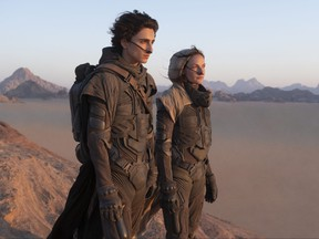 Timothée Chalamet as Paul Atreides and Rebecca Ferguson as Lady Jessica Atreides in Warner Bros. Pictures and Legendary Pictures' action adventure Dune, a Warner Bros. Pictures release.