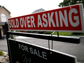 """A real estate sign that reads """"For Sale"""" and """"Sold Above Asking"""" in Vaughan."""