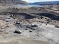 n the area between the two coffer dams, crews excavate and prepare the dam core area, in June 2021, where the earth-fill dam will be constructed — and where the latest setback has been experienced.