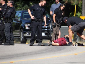 An unidentified man is detained in Kerrisdale neighbourhood on the early morning of July 10, 2021. Vancouver police were at the scene of a homicide at a home near South West Marine Drive and West 57th Avenue.