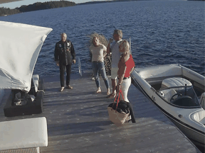 Screen shot of security video shows Linda O'Leary (second from left), wife of celebrity investor Kevin O'Leary (left), with their speedboat on the evening of the fatal crash.