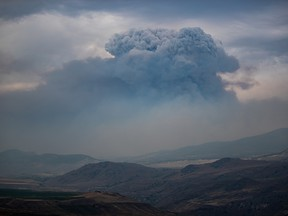 A pyrocumulus cloud, also known as a fire cloud, forms in the sky as the Tremont Creek wildfire burns on the mountains above Ashcroft on Friday, July 16, 2021. Darryl Dyck