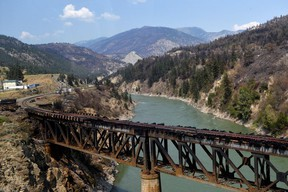 The charred remnants of the rail bridge, destroyed by a wildfire on June 30, is seen during a media tour by authorities in Lytton, British Columbia, Canada July 9, 2021.