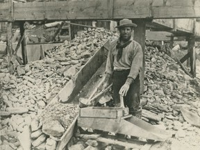 """Miner Bill Phinney works a """"hand rocker"""" on the Caledonia Claim at Williams Creek during the Cariboo Gold Rush in the British Columbia Interior in the 1860s."""