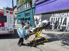 Paramedics respond to an emergency medical call in the 100-block E. Hastings Street in Vancouver, BC Thursday, April 22, 2021.