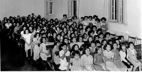 Update handout photo of students in assembly hall of the Alberni Indian Residential School. Undated.