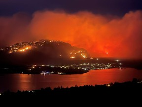Smoke billows from a wildfire, seen from Highway 3 lookout near Osoyoos city, British Columbia, Canada July 20, 2021, in this picture obtained from social media.