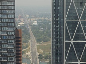 Smoke from wildfires in B.C. and the U.S. obscures Calgary on Thursday, July 15, 2021.