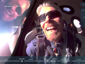 Billionaire Richard Branson reacts on board Virgin Galactic's passenger rocket VSS Unity after reaching the edge of space above Spaceport America, near Truth or Consequences, New Mexico, on July 11.