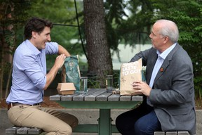 Prime Minister Justin Trudeau and B.C. Premier John Horgan meet for a White Spot lunch in the courtyard at Coquitlam City Hall on Thursday, July 8, 2021.