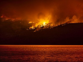 The White Rock Lake fire burns near Vernon's Westside on Friday evening (Aug. 6, 2021). In the top left of the image you can see the ember shower.
