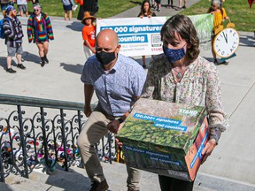 Green MLAs Adam Olsen and Sonia Furstenau after receiving a 150,000-name petition to stop old-growth logging.