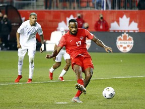 Canadian striker Cyle Larin scores on a second-half penalty against Honduras during their World Cup qualifying match at BMO Field in Toronto on Thursday night. Canada and Honduras played to a 1-1 draw.