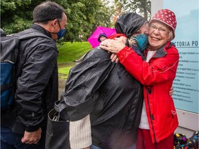 Marlene Lavallee hugs her son's wife, Lee Ann Mangin, as son Paul Lavallee, left, looks on after the Clipper arrived in the Inner Harbour on Friday.