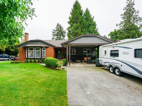 This West Cloverdale rancher was listed for  $1,250,000 and sold for  $1,279,000.