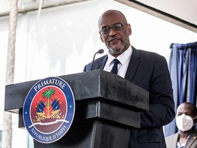In this file photo, Designated Prime Minister Ariel Henry speaks during a ceremony at La Primature in Port-au-Prince, Haiti, on July 20, 2021.