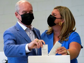 Canada's opposition Conservative Party leader Erin O'Toole and his wife Rebecca cast their ballots for the federal election, in Bowmanville, Ont., Sept. 20, 2021.