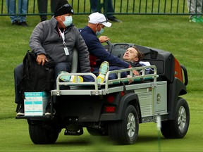 Tom Felton is carted off the course after collapsing during the celebrity matches ahead of the 43rd Ryder Cup at Whistling Straits on Sept. 23, 2021 in Kohler, Wisconsin.