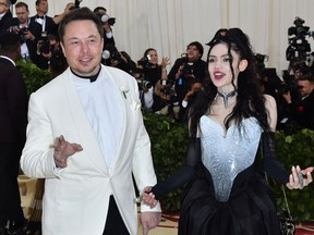 In this file photo taken on May 7, 2018 Elon Musk and Grimes arrive for the 2018 Met Gala, at the Metropolitan Museum of Art in New York.
