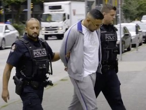 Police made the seizures during a 2018 investigation that included the arrest of Gary Kang, seen in handcuffs being escorted by two Vancouver Police . Gary Kang was murdered earlier this year as part of the Lower Mainland gang war.