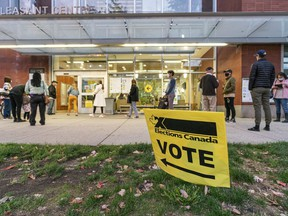 Voters waiting outside Mt. Pleasant Community Centre to cast their ballots in the 2021 federal election, even after the polls had officially closed in Vancouver on Monday night.