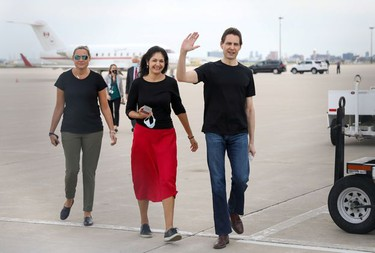 Former diplomat Michael Kovrig, his wife Vina Nadjibulla and sister Ariana Botha react following his arrival on a Canadian air force jet after his release from detention in China, at Pearson International Airport in Toronto, Ontario.