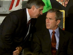 Then-U.S. president George W. Bush listens as chief of staff Andrew Card tells him a second plane has hit the World Trade Center. Bush was reading with children at the Emma E. Booker Elementary School, in Sarasota, Florida at the time of the attack on Sept. 11, 2001.