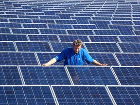 A technician checking on solar panels. 'Green' jobs have been held up as a new economic driver that could offset oil and gas job losses.