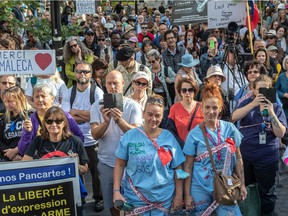 Montrealers protested against vaccine mandates in Montreal on Saturday, Oct. 9, 2021.