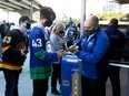 Fans are welcomed back into Rogers Arena with proof of vaccination as the Vancouver Canucks take on the Winnipeg Jets during their preseason NHL game at Rogers Arena on Oct. 3, 2021.