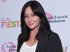 """In this file photo Actress Shannen Doherty walks the carpet at the Farrah Fawcett Foundation's """"Tex-Mex Fiesta"""" honouring Marcia Cross at Wallis Annenberg Center for the Performing Arts in Beverly Hills, Calif., on Sept. 6, 2019."""
