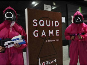 """Participants take part in an event where they play the games of Netflix smash hit """"Squid Game"""" at the Korean Cultural Centre in Abu Dhabi, on October 12, 2021."""