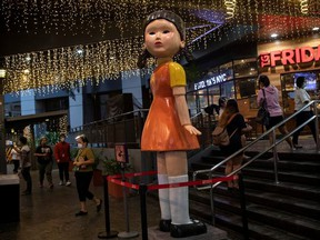 """A 3-metre (10 ft) tall doll from Netflix series """"Squid Game"""" is displayed outside a mall in Quezon City, Philippines, September 30, 2021."""