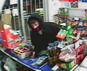 A surveillance camera image of a robber who struck the Mapleleaf variety store at 8151 Wyandotte St. East in Windsor, Ont. on Sunday, April 15, 2012.