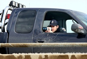 Windsor Police Const. Dave Repko uses a radar gun on top of the Central Avenue overpass at the E.C. Row Expressway in this file photo. (NICK BRANCACCIO/The Windsor Star.)