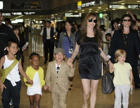 Actress Angelina Jolie is accompanied by her children Maddox in this file photo. (YOSHIKAZU TSUNO/AFP/Getty Images)