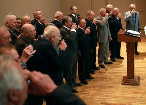 Members of Il Coro Italiano of Windsor toast their final performance at the Caboto Club, Sunday, Nov. 4, 2012.  (DAX MELMER/The Windsor Star)