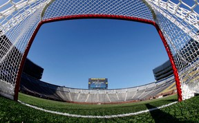 n this Feb. 9, 2012, file photo, a view from inside a hockey net shows Michigan Stadium in Ann Arbor, Mich., after the announcement of the NHL Winter Classic hockey game.  (Paul Sancya/AP)