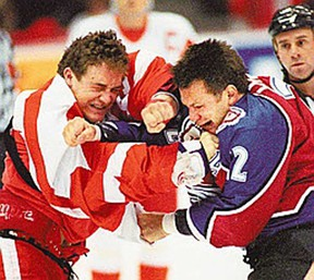 In this file photo, It took all of three seconds into a NHL game here before Darren McCarty, left, of the Red Wings and Claude Lemieux of the Colorado Avalanche started fighting. (Windsor Star files)