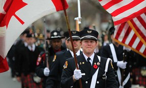 Active and retired firefighters participate in the annual Fallen Fire Fighters Memorial March as they march down Giles Boulevard East in Windsor, Ont., Sunday, Nov. 4, 2012.  (DAX MELMER/The Windsor Star)