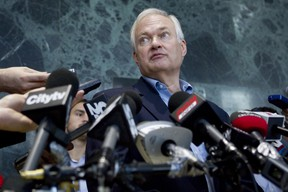 Donald Fehr, executive director of the NHPLA, speaks with the press following talks with the NHL in Toronto in late Auguest. (THE CANADIAN PRESS/Chris Young)