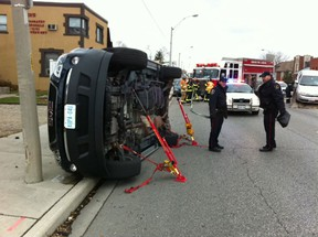 A GMC Acadia rests on its side after rolling over in the 3200 block of Tecumseh Road East on Friday, Nov. 23, 2012. (NICK BRANCACCIO/The Windsor Star)