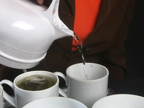 File photo of a woman pouring hot water on to a tea bag. (Postmedia News files)
