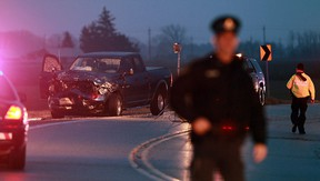 OPP officers investigate at the scene of a two vehicle accident on Walker Road near County Road 15 north of Harrow on Tuesday, January 29, 2013. (TYLER BROWNBRIDGE / The Windsor Star)