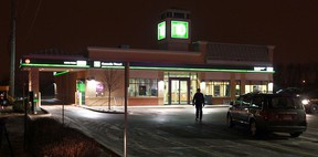 OPP officers investigate at the scene of a robbery at the TD Canada Trust bank on Tecumseh Road east of Banwell Road in Tecumseh on Thursday, January 31, 2013.         (TYLER BROWNBRIDGE / The Windsor Star)
