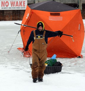 Jeff Galasso packs up his fishing tent during Friday's winter stormas area residents and motorists battle the elements during a winter storm Friday February 8, 2013.  The storm did not bother the fishing though, with several anglers reporting 'jumbo' perch. (NICK BRANCACCIO/The Windsor Star)